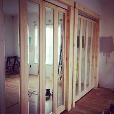 rustic closet door with white oak wood bifold frame and full length