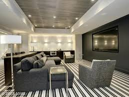 Contemporary Home Theater with Custom Allure Double Chaise Sectional,  Absolute Black Granite, Wall sconce