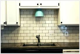 subway tile off white cabinets kitchen with gray backsplash