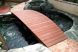 building a koi pond completed pond bridge diy koi pond uk