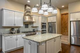 what you should know about refinishing kitchen cabinets according to a pro