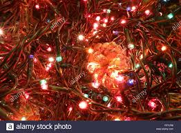 Cone Lights Christmas Christmas Background With Golden Pine Cone And Colored Led