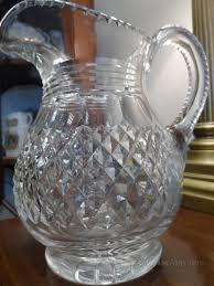 heavy cut glass water jug