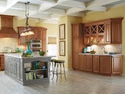 stone countertops kitchen cabinets at menards lighting flooring sink faucet island backsplash diagonal tile marble red oak wood honey glass panel door