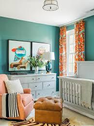 blue and orange boy nursery with gray paneled crib
