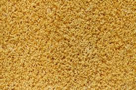 yellow carpet texture. texture of a yellow carpet with long pile. stock photo - 6371656