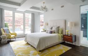 area rugs bedroom. lovely yellow and white bedroom with an armchair pendant lighting featuring hardwood flooring wool area rug rugs d
