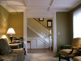 faux wood coffered ceiling cost with armchair and brown wall for home  decoration ideas