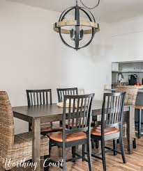 small dining room with rustic chandelier during makeover worthing court