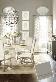 gray dining room with pedestal table and white upholstered chairs benjamin moore galveston gray ac 27