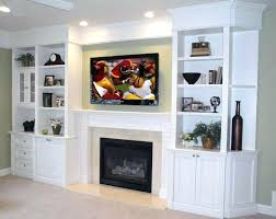 shelf over a fireplace wall space behind painted a diffe color shelving units on sides protrude