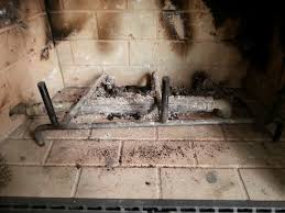 it is a gas fireplace so i can replace the missing gas log can you tell by the attached pictures if it is a gas fireplace or a traditional fireplace