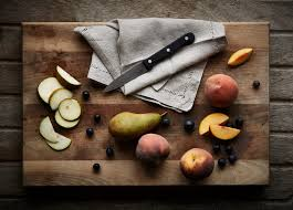 cutting board with food. Chopping Board With Sliced Pear And Apricots Cutting Food