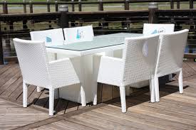 white wicker outdoor furniture astonishing design armchairs rectangle dining table clear solid glass top surface decoration