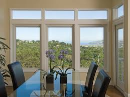 this homeowner opted for a dramatic combination of picture windows in the dining room