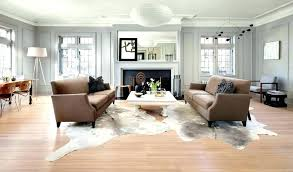 rug over carpet area on top of beautiful cowhide living room and m va carpet on living room area rug
