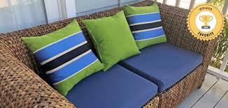 bright pillows pop against sunbrella rain loveseat cushions