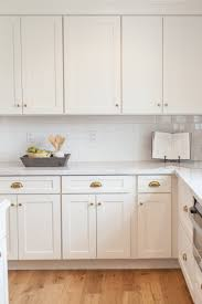 white cabinet handles. Traditional Antique White Kitchen Welcome! This Photo Gallery Has Pictures Of Kitchens Featuring Cream Or · Brass HardwareGold Cabinet Handles L