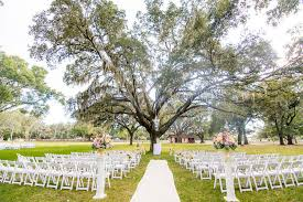 outdoor florida wedding ceremony under spanish moss covered oak tree outdoor private estate wedding venue in brandon florida ta bay florida wedding