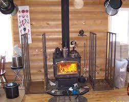 Wood Stove with indoor large firewood racks.