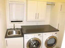 sublime stainless steal laundry room sinks with faucet also black countertop plus cabinet