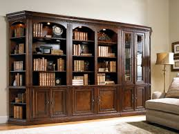 antique mahogany large home office unit. Vintage Design Of Mahogany Wooden Bookcase With Arched Top Column Also Tall Glass Door On The Left Over Beige Floor Antique Large Home Office Unit O
