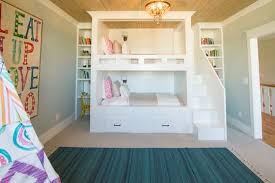 built in bunk beds. Simple Bunk This Builtin Bunk Bed Unit Features Extra Storage And Stairs Leading To  The Top In Built Bunk Beds B