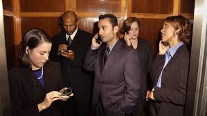 awkward people in elevator. you find yourself obsessively scrolling through your phone to feel less awkward throughout the elevator ride. people in a