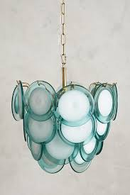this oceanic pendant is an illuminating evocation of ocean waves and smooth sea glass rendered in rows of scalloped aqua glass 998 here
