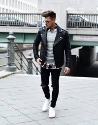 checked shirt gray sweater leather biker jacket ripped jeans and white sneaker
