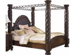 North Shore King Canopy Bed in Dark Wood - Ashley Signature Design