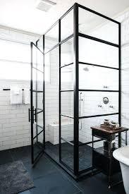 black steel framed shower door enclosure with white subway tile surround doors