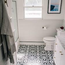 bathroom with black and white ceramic tile flooring