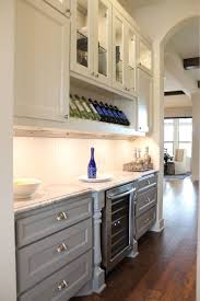 burrows cabinets butler s pantry with terrazzo door style in custom white and grey paint with