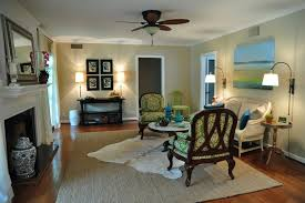inspired seagrass rugs in living room traditional with area rug over carpet next to rug alongside layered rugs and cowhide rug