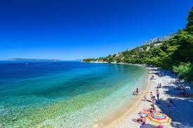 the beaches in the centre of podgora are situated in front of the local hotels right next to the main promenade the one kilometre long central beaches are