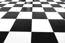 Black and white checkerboard tile provides a clean, crisp appearance to a  kitchen floor.
