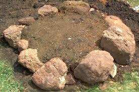 first course of a small circular rock garden