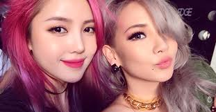 fans going crazy over cl s beautiful pink haired makeup artist