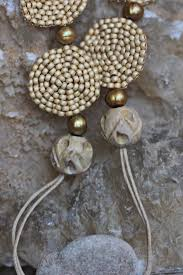 this short necklace in beige gold bears a stone from crete greece found by me during summer holidays you can try imagining the whole church in this