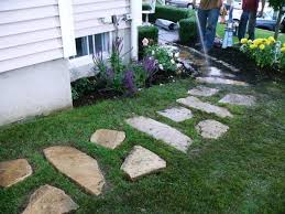 wash off the stones with a garden hose to remove debris and help resettle the grass