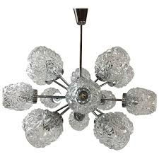 fifteen arm sputnik chandelier attributed to richard essig for