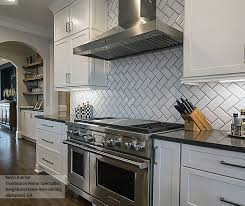 white shaker cabinets with a large kitchen island what are43