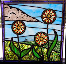 stained glass window panel with fused glass inclusions as well as glass on glass flower inclusions