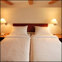This, believe it or not, is what many people in Europe think is a double bed.  It's clearly two single beds pushed together, but they call it a double bed  or ...