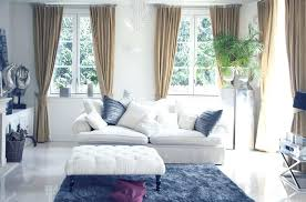 matching rug and curtains living room with blue area rug white couch and curtained windows matching rug pillow and curtains