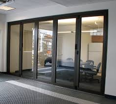 terrific closed interior folding glass wall with black wooden frame for office meeting room