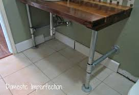 industrial bathroom vanity. pipe legs save · industrial remodel bathroom vanity