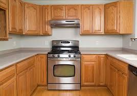 a kitchen before of cabinet transformations