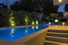 view in gallery illuminated pool area with a spherical outdoor lamp